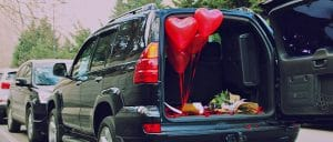 Heart balloons in the back of a car