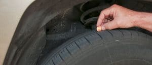 Checking tire health with penny test