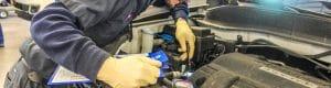 Mechanic inspecting car