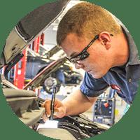 technician inspecting car under the hood