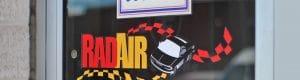 rad air logo on a glass door entrance to rad air location